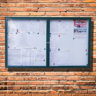 Tradition 30 Dual Door External Notice Board - Green Frame - Holds 8 x A4